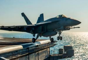 An F/A-18E Super Hornet launches from the aircraft carrier USS Carl Vinson